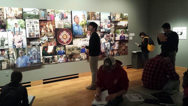 students looking at a history exhibit in a museum